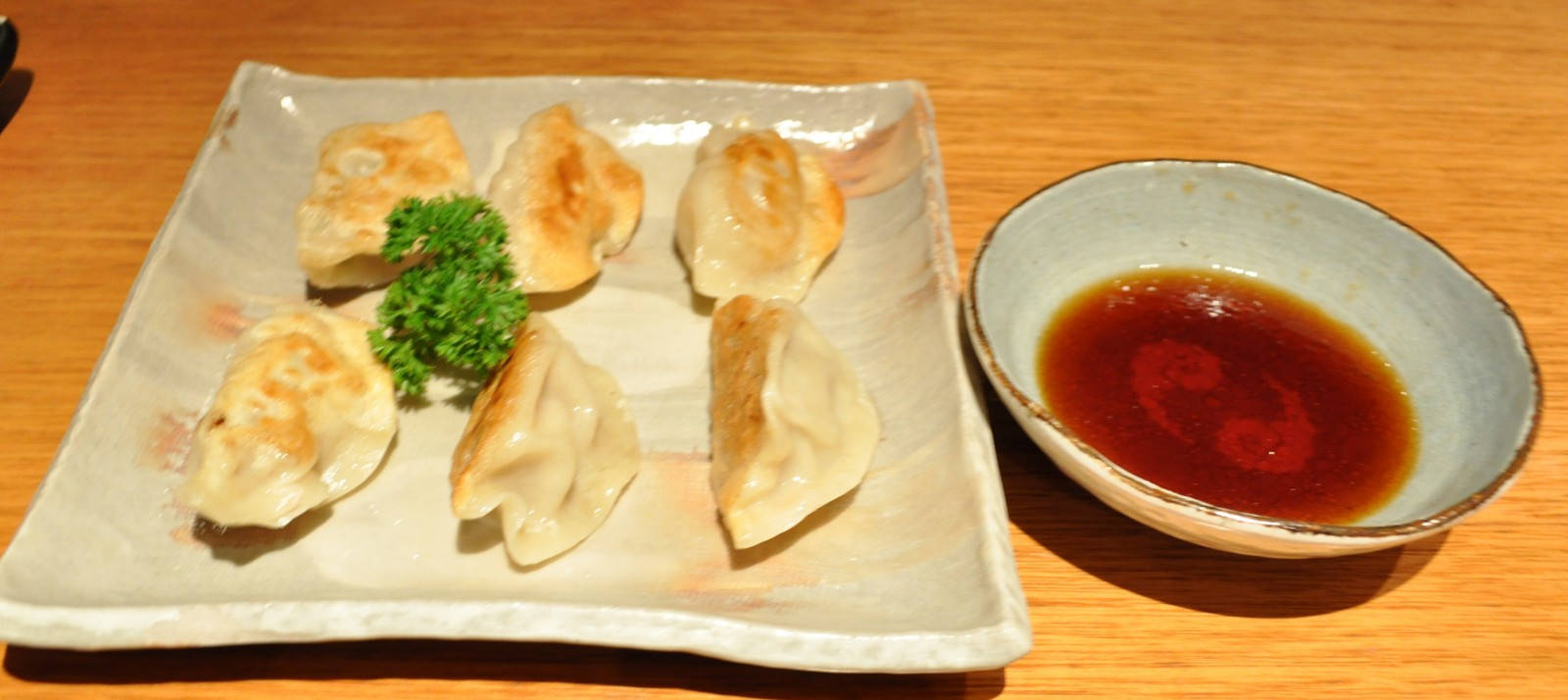 Gyoza - pan-fried Japanese pork dumplings served with dipping sauce $ ...