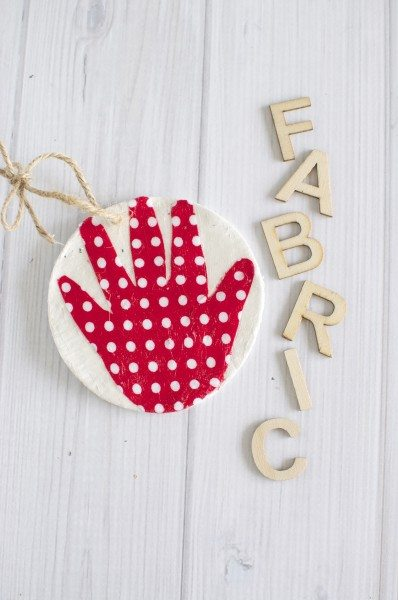 Baby's first Christmas fabric hand ornament via www.clairekcreations.com
