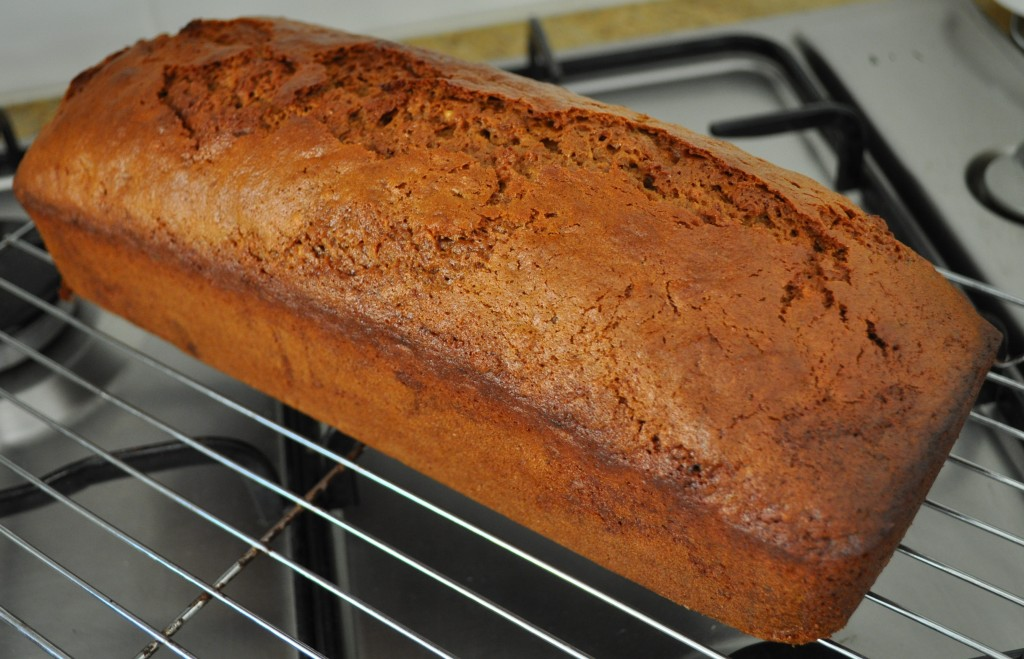 Cafe style banana bread cooling on a rack