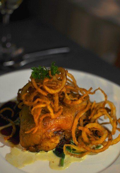Crispy roasted duck, garlic spinach, orange & thyme jus, crispy onion rings $36