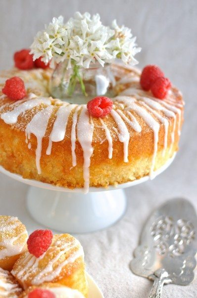 Vanilla almond cake with lemon drizzle and raspberries