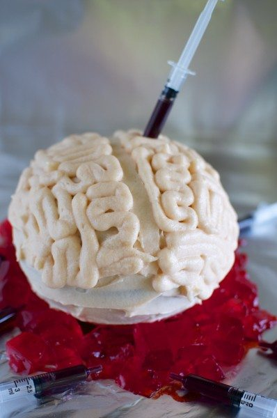Brain piñata cake filled with bloody maggots via www.clairekcreations.com