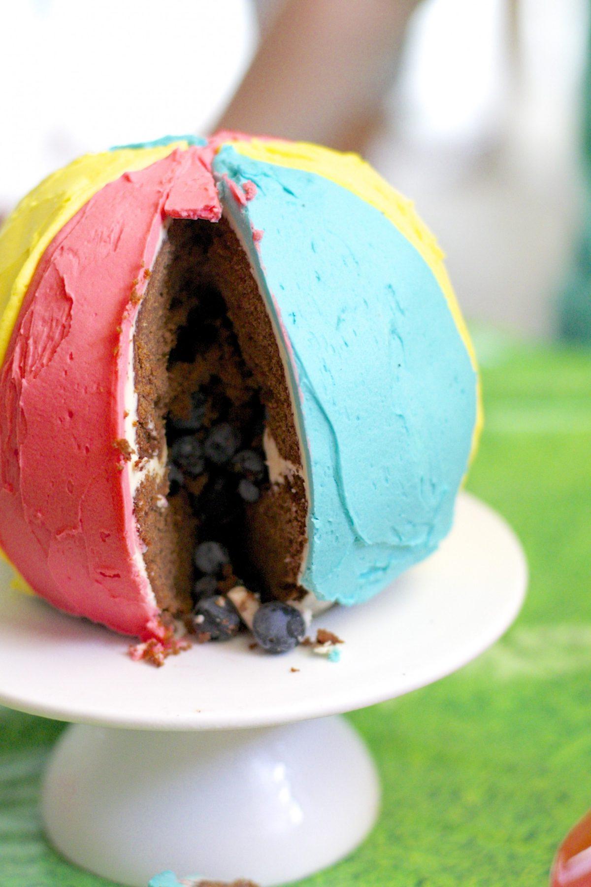 Beach ball piñata cake