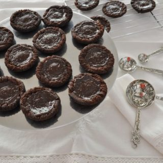 Salted caramel chocolate tarts - death by chocolate sweet adventures blog hop